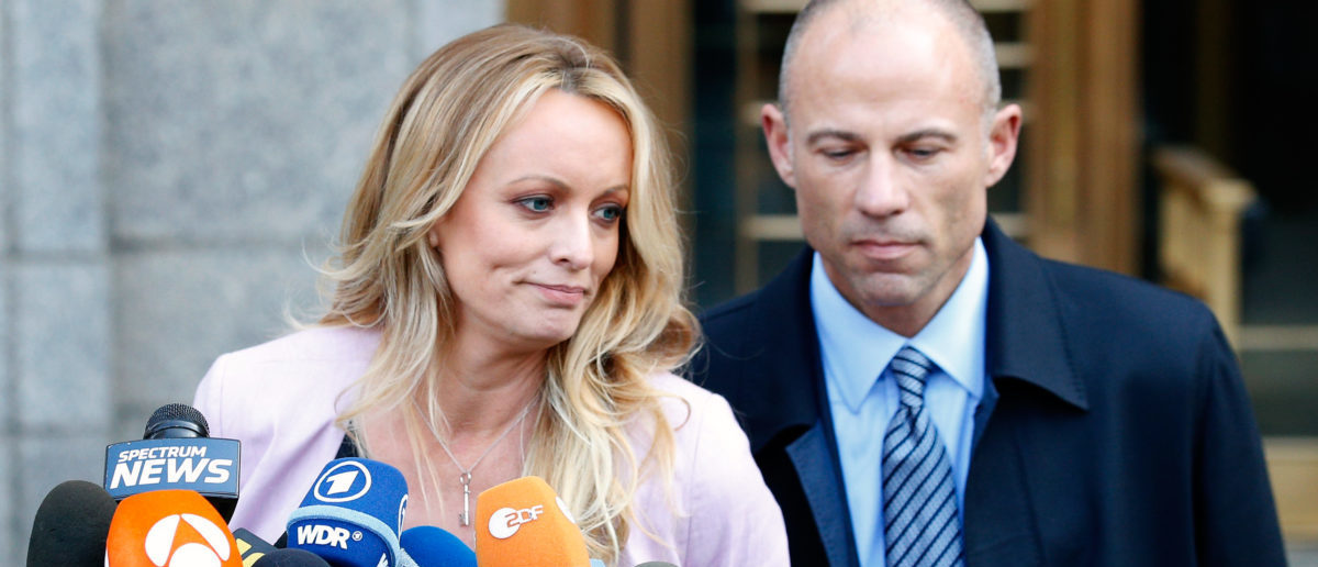 Adult film actress Stephanie Clifford, also known as Stormy Daniels, speaks to media along with lawyer Michael Avenatti (R) outside federal court in the Manhattan borough of New York City, New York, U.S., April 16, 2018. REUTERS/Brendan Mcdermid