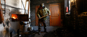 A worker loads coal into the furnace for heating the school in the remote village of Soino in Smolensk region, Russia March 19, 2018. In this school the number of students has steadily decreased from two hundred at the time the school was opened about 40 years ago to six today. Nevertheless the school authorities and teachers are proud of the high level of education given to the few students who are treated individually and carefully here. Picture taken March 19, 2018  REUTERS/Vasily Fedosenko