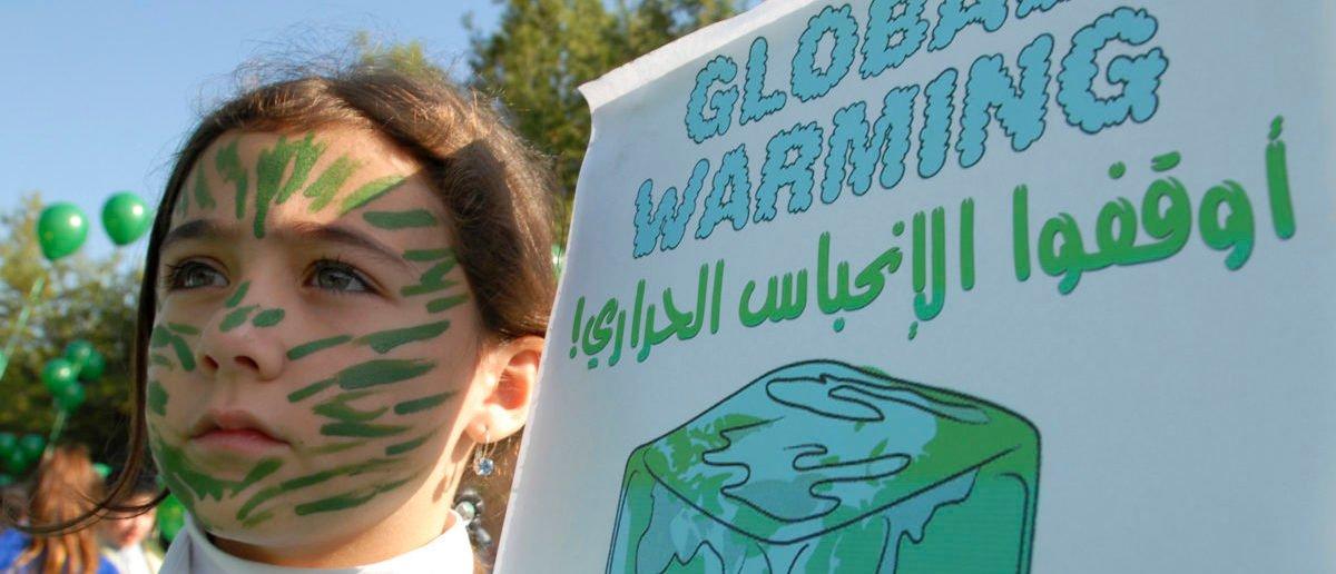 A child holds up a poster as she takes part in a demonstration in Sidon, southern Lebanon, demanding action against climate change December 8, 2009. The demonstration was held to mark the 2009 United Nations Climate Change Conference in Copenhagen. REUTERS/Raafat Naeem