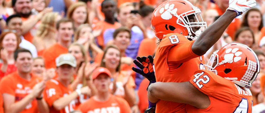Wide receiver Deon Cain #8 of the Clemson Tigers celebrates with Christian Wilkins #42 of the Clemson Tigers after making a touchdown reception during the game at Memorial Stadium on October 7, 2017 in Clemson, South Carolina. (Photo by Mike Comer/Getty Images)