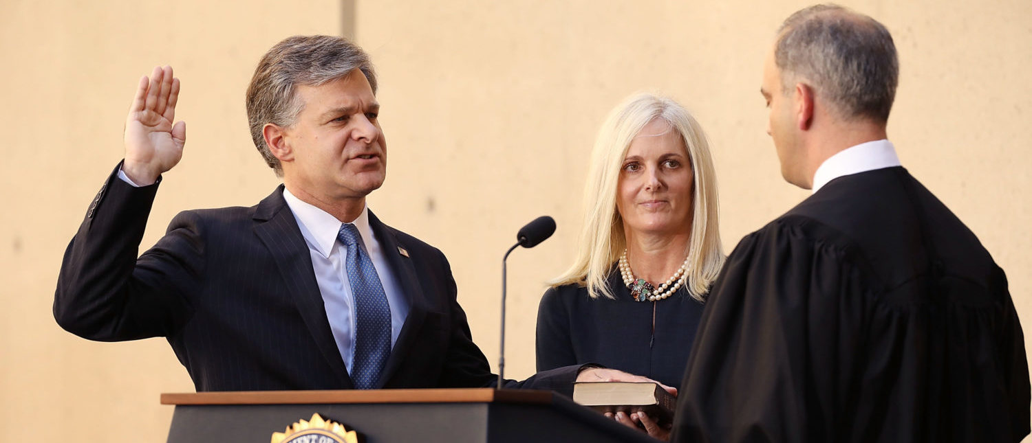 WASHINGTON, DC - SEPTEMBER 28: Federal Bureau of Investigation Director Christopher Wray (L) is ceremonially sworn in to office by U.S. District Court Judge Joseph Bianco as Wray's wife, Helen Wray, looks on at FBI headquarters September 28, 2017 in Washington, DC. Wray was appointed by President Donald Trump after he fired former FBI Director James Comey on the recommendation of Sessions and Deputy Attorney General Rod Rosenstein. (Photo by Chip Somodevilla/Getty Images)