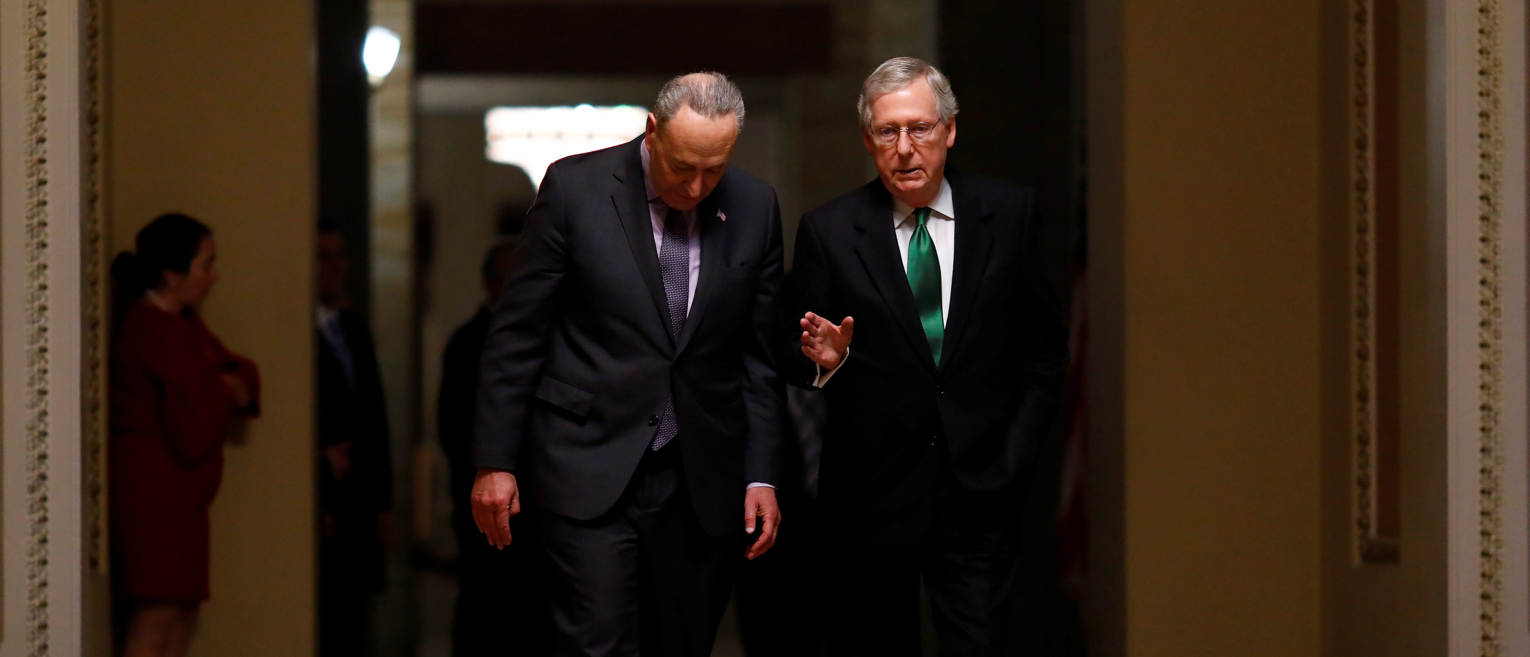 Senate Minority Leader Chuck Schumer (D-NY) and U.S. Senate Majority Leader Mitch McConnell (R-KY) walk to the Senate chamber on Capitol Hill in Washington, D.C., February 7, 2018. REUTERS/Eric Thayer