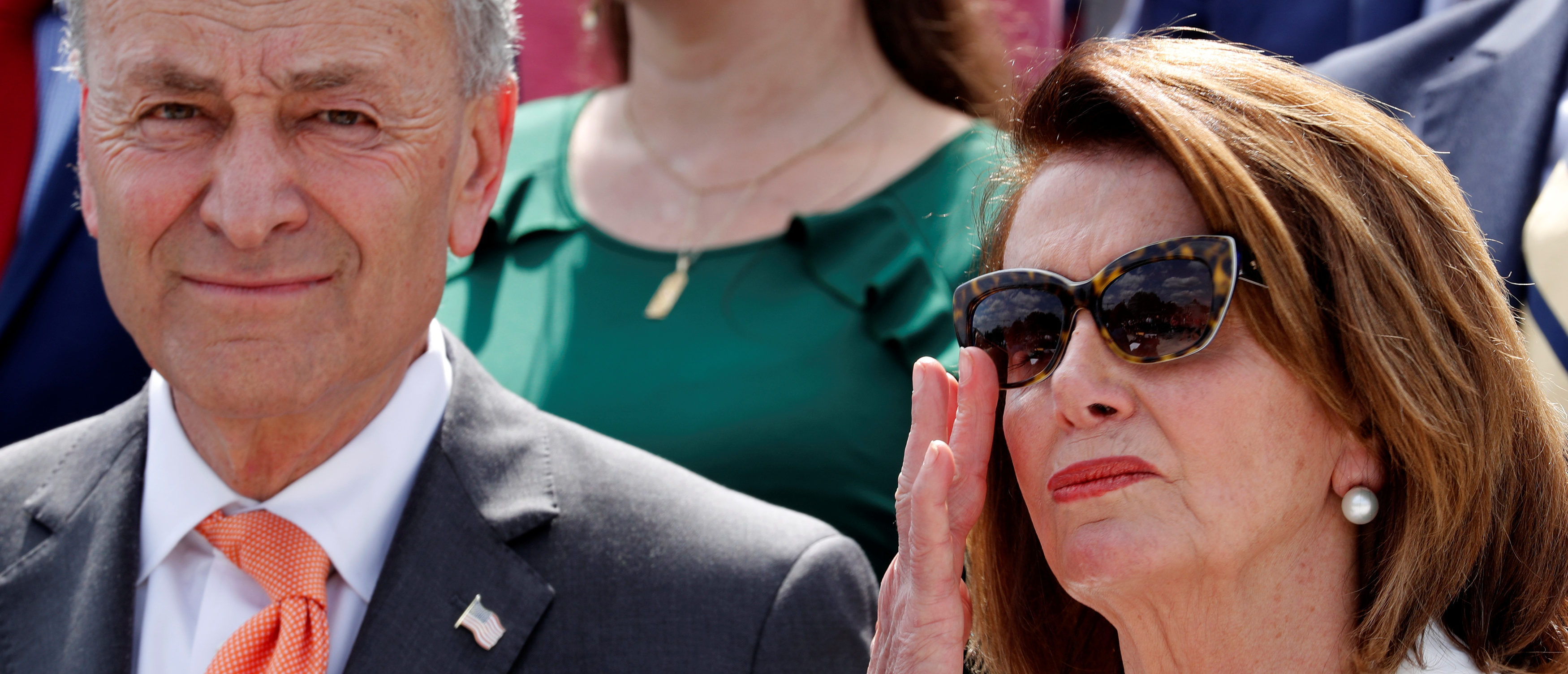 """U.S. House Minority Leader Nancy Pelosi (D-CA) leads Democratic members of Congress, including Senate Minority Leader Chuck Schumer (D-NY) (L), during their """"Better Deal"""" platform rally at the U.S. Capitol in Washington, May 21, 2018. REUTERS/Jonathan Ernst"""
