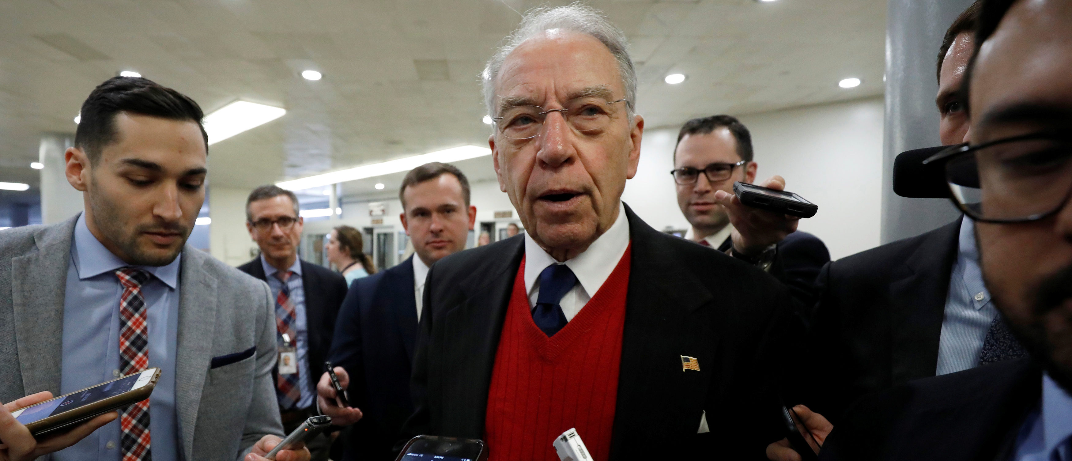 Sen. Chuck Grassley speaks with reporters ahead of votes on Capitol Hill in Washington, U.S., December 6, 2017. REUTERS/Aaron P. Bernstein - RC1377255B10