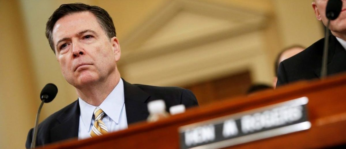 FILE PHOTO: Then-FBI Director James Comey testifies before the House Intelligence Committee hearing into alleged Russian meddling in the 2016 U.S. election, on Capitol Hill in Washington, U.S., March 20, 2017. REUTERS/Joshua Roberts/File Photo
