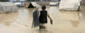 An Afghan man carries a solar panel as he wades through flood waters in the Behsud District of Nangarhar province, February 25, 2015. Four people were killed and hundred houses have been damaged after a heavy rain and flood in Nangarhar province of Afghanistan, the provincial spokesman Ahmadzia Abdulzai said. REUTERS/Parwiz (AFGHANISTAN - Tags: DISASTER ENVIRONMENT TPX IMAGES OF THE DAY) - GM1EB2P1QRM01   Solar Panels Carry Toxic Chemicals