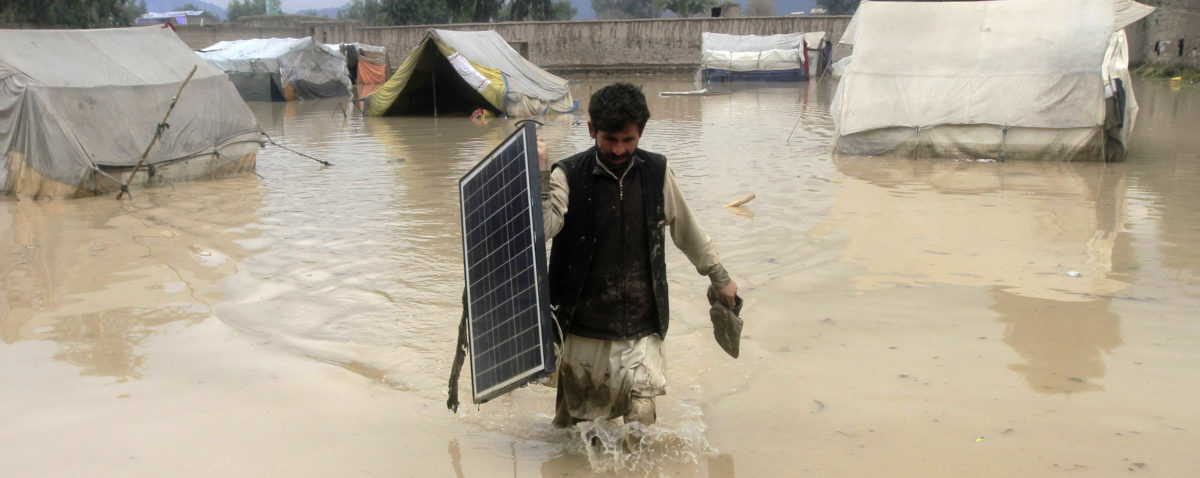 An Afghan man carries a solar panel as he wades through flood waters in the Behsud District of Nangarhar province, February 25, 2015. Four people were killed and hundred houses have been damaged after a heavy rain and flood in Nangarhar province of Afghanistan, the provincial spokesman Ahmadzia Abdulzai said. REUTERS/Parwiz | Solar Panels Carry Toxic Chemicals