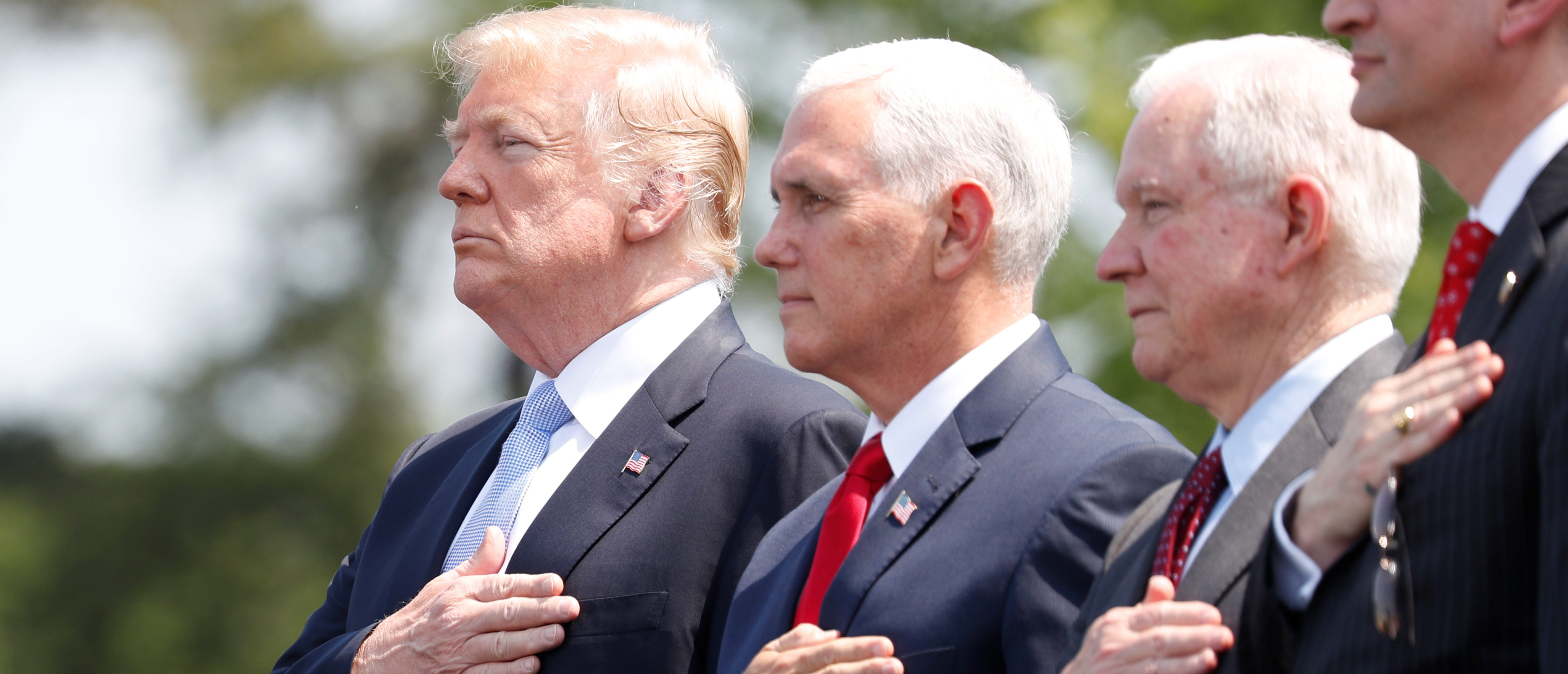 President Donald Trump stands with Vice President Mike Pence and Attorney General Jeff Sessions at the 37th Annual National Peace Officers' Memorial Service  at the U.S. Capitol in Washington, May 15, 2018. REUTERS/Kevin Lamarque