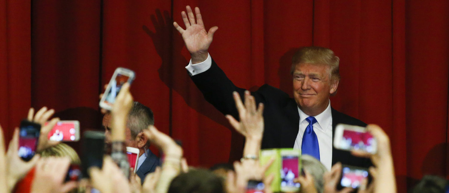 TOPSHOT - Republican presidential candidate Donald Trump waves to the crowd at a fundraising event in Lawrenceville, New Jersey on May 19, 2016. (Photo: EDUARDO MUNOZ ALVAREZ/AFP/Getty Images)