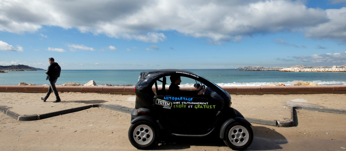 A man drives a Totem-Mobi electric car-sharing vehicle in Marseille, France March 6, 2018. REUTERS/Jean-Paul Pelissier