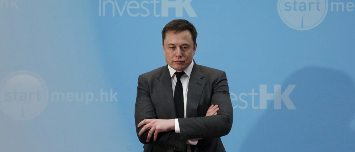 Tesla Chief Executive Elon Musk stands on the podium as he attends a forum on startups in Hong Kong, China January 26, 2016. REUTERS/Bobby Yip