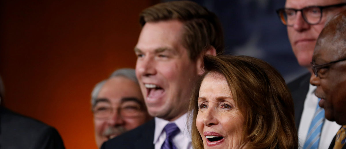 U.S. House Minority Leader Nancy Pelosi (D-CA) (R), flanked by Representative Steny Hoyer (D-MD) (L) and Representative Eric Swalwell (D-CA) (2nd L), laughs during a news conference with Democratic leaders on the Republicans' attempt to repeal the Obamacare health care legislation at the U.S. Capitol in Washington, U.S., March 24, 2017.  REUTERS/Jonathan Ernst