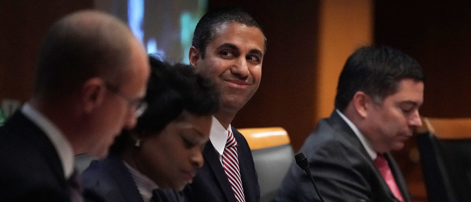 WASHINGTON, DC - DECEMBER 14: Federal Communications Commission Chairman Ajit Pai (3rd L) smiles during a commission meeting December 14, 2017 in Washington, DC. FCC has voted to repeal its net neutrality rules at the meeting. (Photo by Alex Wong/Getty Images)