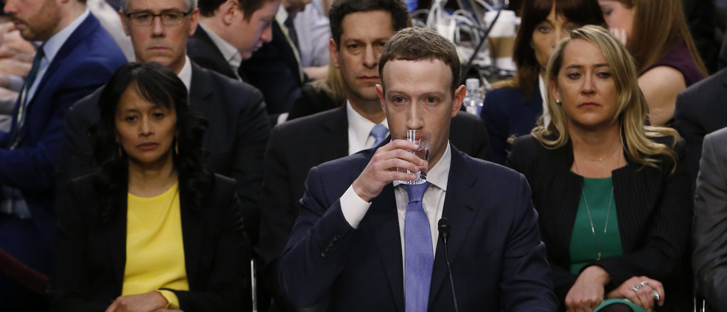 Facebook CEO Mark Zuckerberg takes a drink while testifying before a Senate Judiciary and Commerce Committees joint hearing regarding the company's use and protection of user data on Capitol Hill in Washington, U.S., April 10, 2018. REUTERS/Alex Brandon
