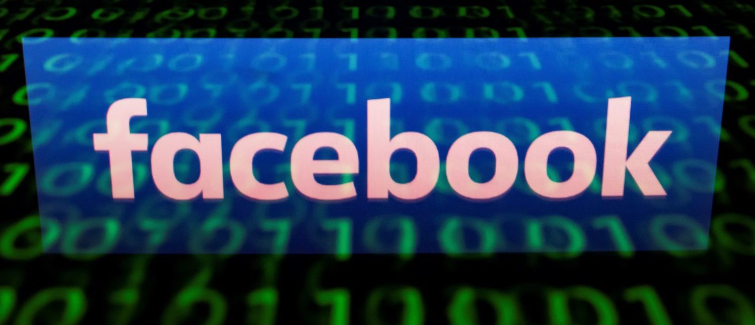 This illustration picture taken on April 29, 2018, shows the logo of social network Facebook displayed on a screen and reflected on a tablet in Paris. (Photo: LIONEL BONAVENTURE/AFP/Getty Images)