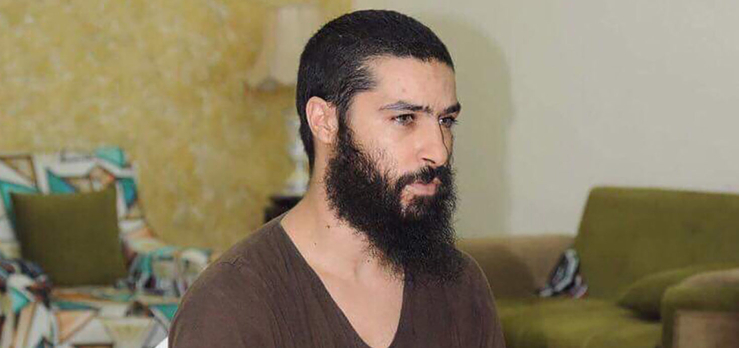 """An undated handout picture released by the Iraqi Judiciary in Baghdad, shows IS member Abu Hamza al-Beljiki (whose real name is Tarik Jadaoun) sitting inside a room. Their names once spread terror across the Islamic State group's cross-border """"caliphate"""", but senior jihadists now sit in Iraqi prisons, subjects of mockery for the populace they ruled. Following the jihadist group's ouster from second city Mosul last July, Iraqi forces went on the hunt for IS fighters who had fled the battlefield. (Photo: HANDOUT / STR/AFP/Getty Images)"""