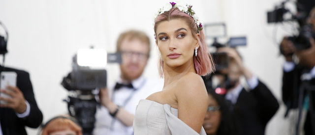 Hailey Baldwin arrives at the Metropolitan Museum of Art Costume Institute Gala (Met Gala) to celebrate the opening of ìHeavenly Bodies: Fashion and the Catholic Imaginationî in the Manhattan borough of New York, U.S., May 7, 2018. REUTERS/Eduardo Munoz - HP1EE5800AR5Z