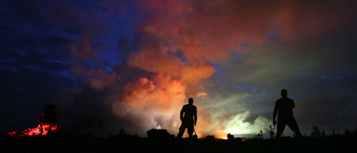 PAHOA, HI - MAY 15:  Photographers work as lava from active fissures illuminates volcanic gases from the Kilauea volcano on Hawaii's Big Island on May 15, 2018 in Hawaii Volcanoes National Park, Hawaii. The U.S. Geological Survey said a recent lowering of the lava lake at the volcano's Halemaumau crater Òhas raised the potential for explosive eruptionsÓ at the volcano.  (Photo by Mario Tama/Getty Images)   Volcano Spurts Ash 30,000 Feet In Sky