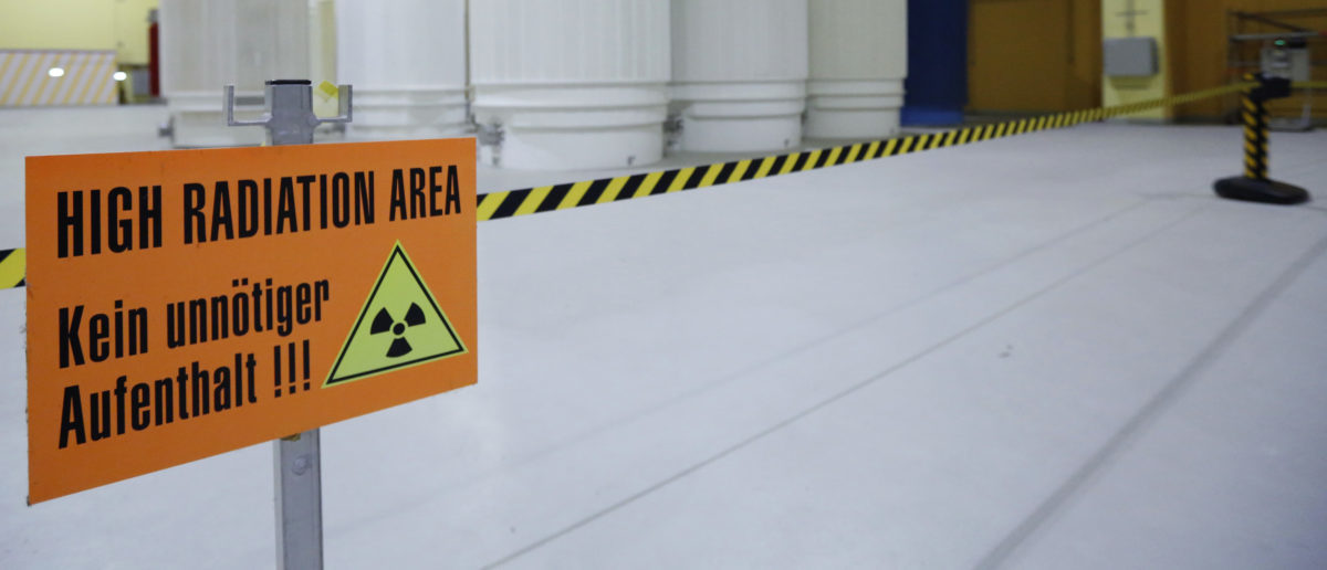 A sign that reads 'High Radiation Area - Avoid unnecessary stay!!!' is pictured in front of Castor nuclear waste containers (Cask for Storage and Transport of Radioactive material) at the ZWILAG interim storage facility for radioactive waste in Wuerenlingen October 30, 2014. Picture taken October 30, 2014. REUTERS/Ruben Sprich