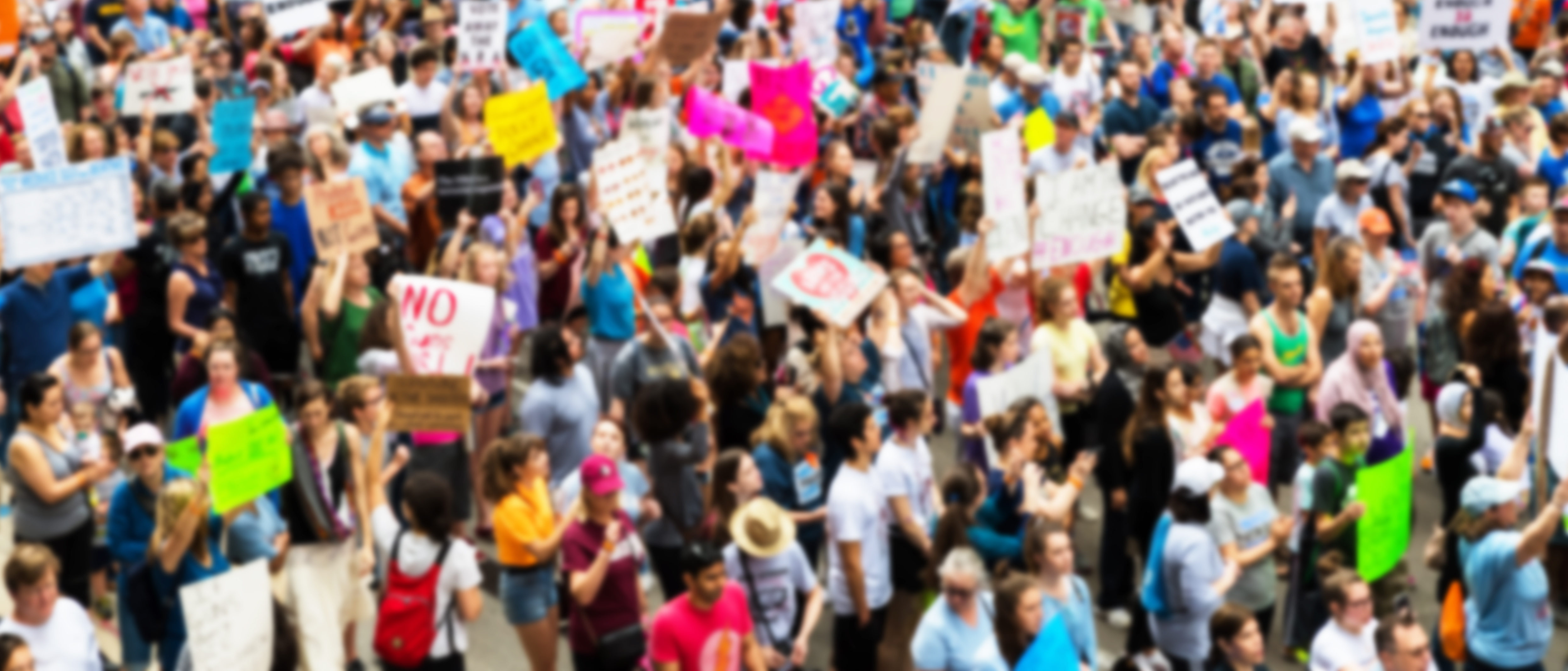 Huge crowd marching (Shutterstock/ michelmond)