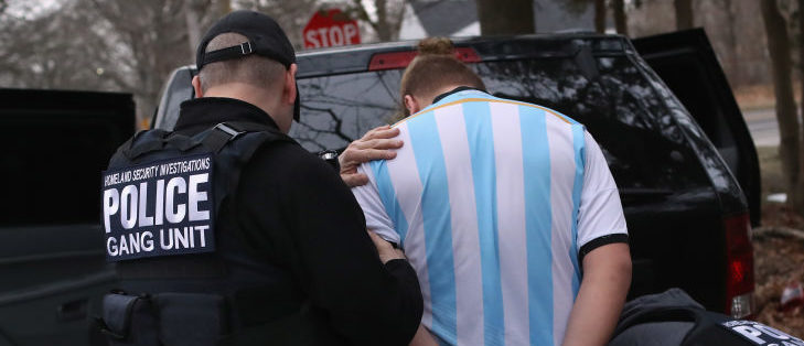 Homeland Security Investigations (HSI) ICE agents frisk a suspected MS-13 gang member and Honduran immigrant after arresting him at his home on March 29, 2018 in Brentwood, New York. Overnight and into the morning federal agents and local police detained suspected gang members across Long Island in a surge of arrests. The actions were part of Operation Matador, a nearly year-long anti-gang effort targeting transnational gangs, with an emphasis on MS-13. (Photo by John Moore/Getty Images)