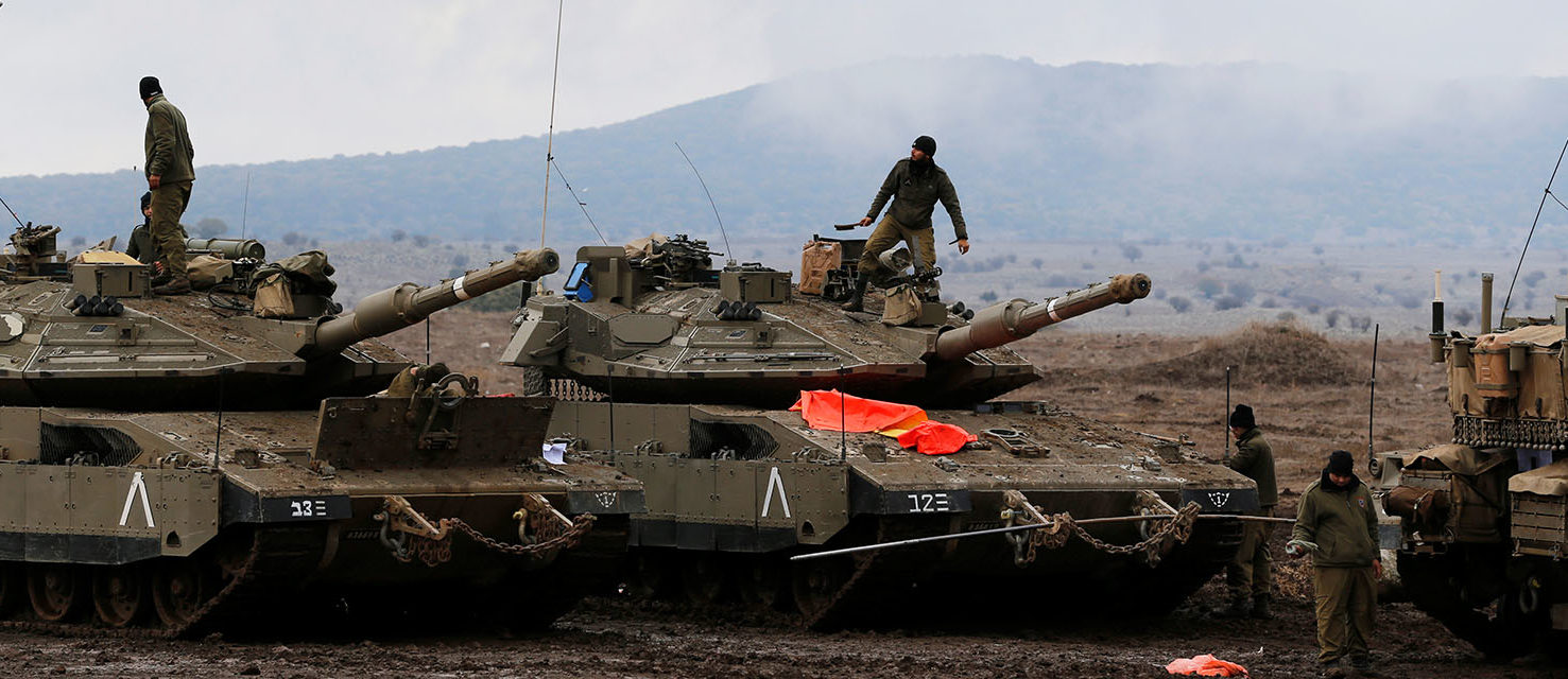 Israeli soldiers stand atop tanks in the Israeli-occupied Golan Heights, close to Israel's frontier with Syria November 22, 2017. REUTERS/Ammar Awad
