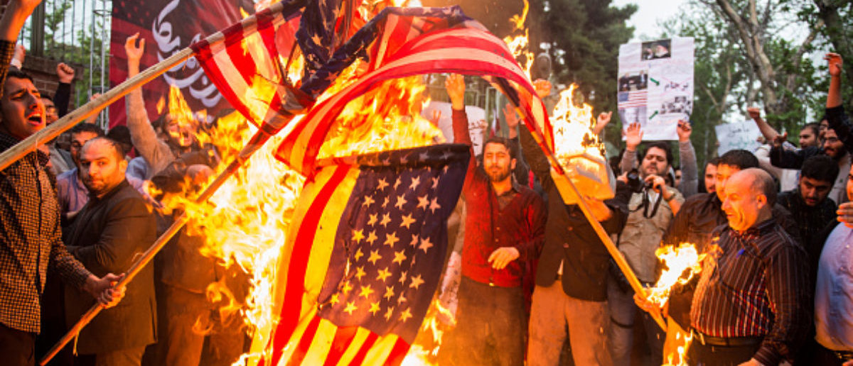 Iranians burn American flags during an anti-U.S. demonstration outside the former U.S. embassy headquarters in Tehran, Iran, on Wednesday, May 9, 2018. (Photo: Ali Mohammadi/Bloomberg via Getty Images)