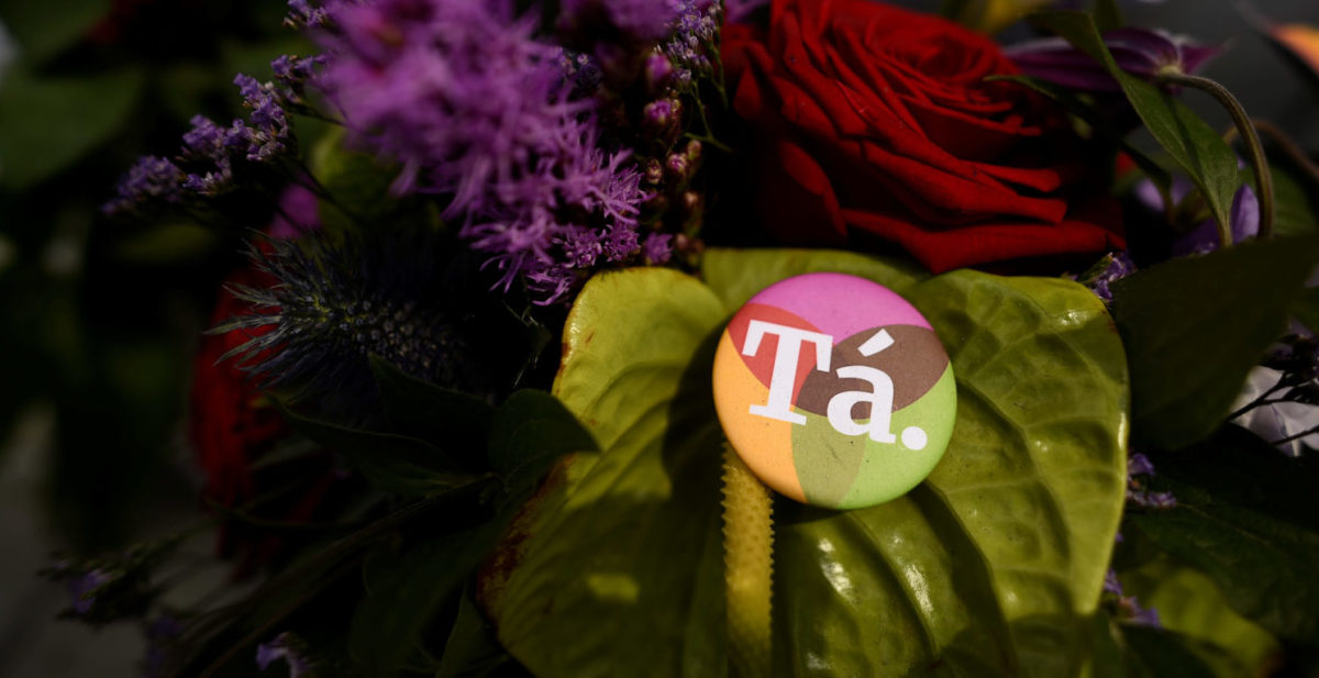 A badge with a message of 'Ta' in Irish language meaning 'Yes' in English is left with flowers at a memorial to Savita Halappanavar a day after an Abortion Referendum to liberalise abortion laws was passed by popular vote, in Dublin, Ireland May 27, 2018. REUTERS/Clodagh Kilcoyne | Irish Archbishops Say Church Is Weakened