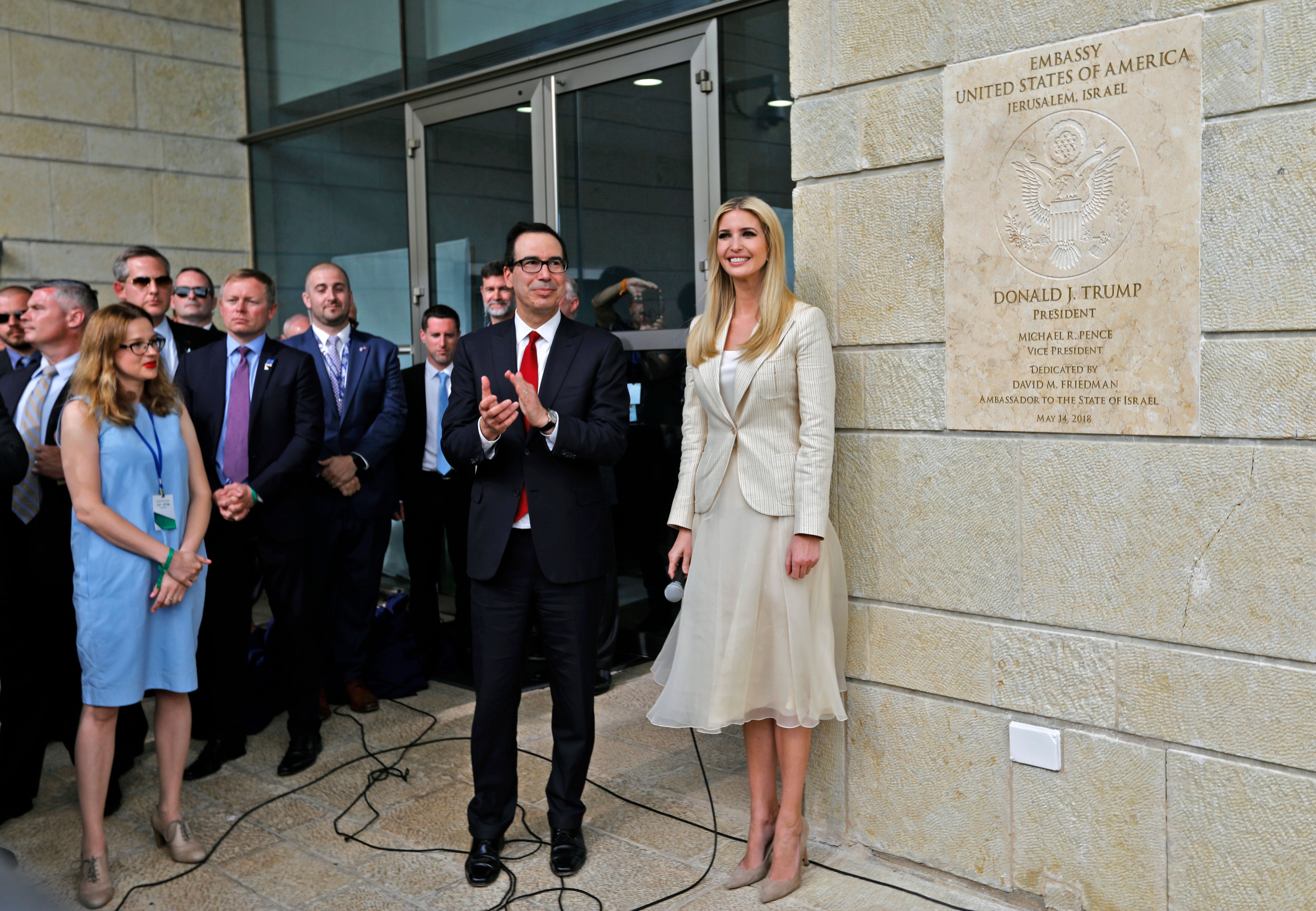 US Treasury Secretary Steve Mnuchin (L) and US President's daughter Ivanka Trump stand next to an inauguration plaque during the opening of the US embassy in Jerusalem on May 14, 2018. - The United States moved its embassy in Israel to Jerusalem after months of global outcry, Palestinian anger and exuberant praise from Israelis over President Donald Trump's decision tossing aside decades of precedent. (Photo by Menahem KAHANA / AFP) (Photo credit should read MENAHEM KAHANA/AFP/Getty Images)