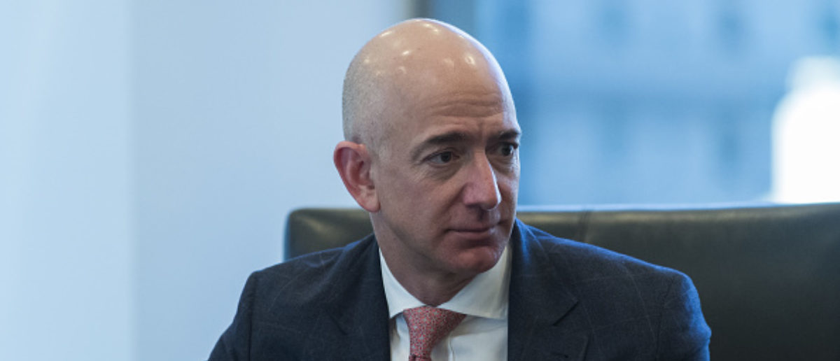 Amazon CEO Jeff Bezos listens during a meeting with U.S. President-elect Donald Trump and technology leaders at Trump Tower in New York, in December, 2016. (Photo: Albin Lohr-Jones/Pool via Bloomberg) | Liberals Force 'Rooney Rule' On Amazon