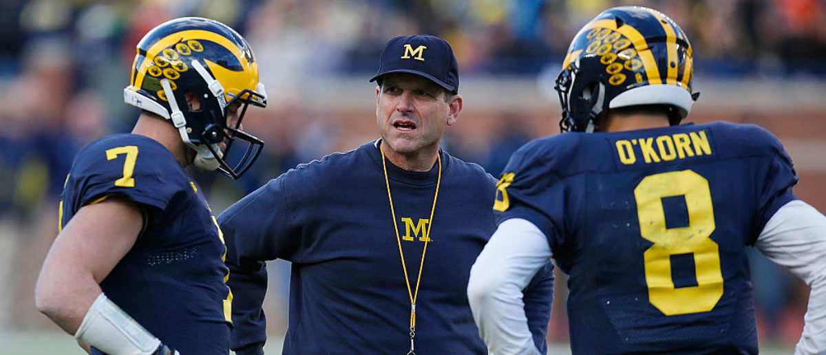 ANN ARBOR, MI - APRIL 01: Head coach Jim Harbaugh of the Michigan Wolverines talks with Shane Morris #7 and John O'Korn #8 during the Michigan spring game on April 1, 2016 at Michigan Stadium in Ann Arbor, Michigan. (Photo by Gregory Shamus/Getty Images)