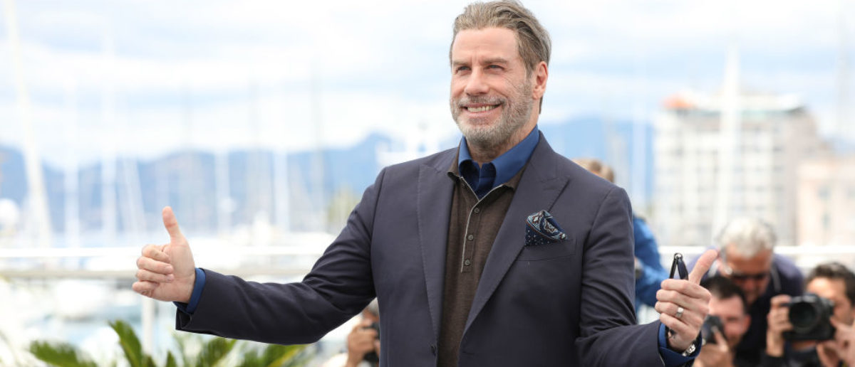 """CANNES, FRANCE - MAY 15: John Travolta attends the photocall for """"Rendezvous With John Travolta - Gotti"""" during the 71st annual Cannes Film Festival at Palais des Festivals on May 15, 2018 in Cannes, France. (Photo by Tristan Fewings/Getty Images)"""