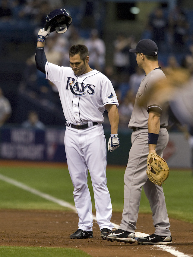 New York Yankees' Mark Teixeira looks on as Tampa Bay Rays' Johnny Damon (L) tips his hat to the fans after hitting a single to pass Lou Gehrig on the all-time hit list during the second inning of their American League MLB baseball game in St. Petersburg, Florida September 27, 2011. REUTERS/Steve Nesius (UNITED STATES - Tags: SPORT BASEBALL) - GM1E79S0P7H01
