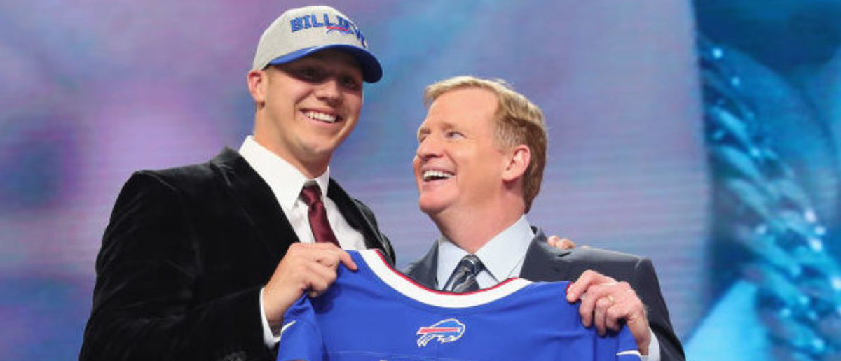 ARLINGTON, TX - APRIL 26: Josh Allen of Wyoming poses with NFL Commissioner Roger Goodell after being picked #7 overall by the Buffalo Bills during the first round of the 2018 NFL Draft at AT&T Stadium on April 26, 2018 in Arlington, Texas. (Photo by Tom Pennington/Getty Images)