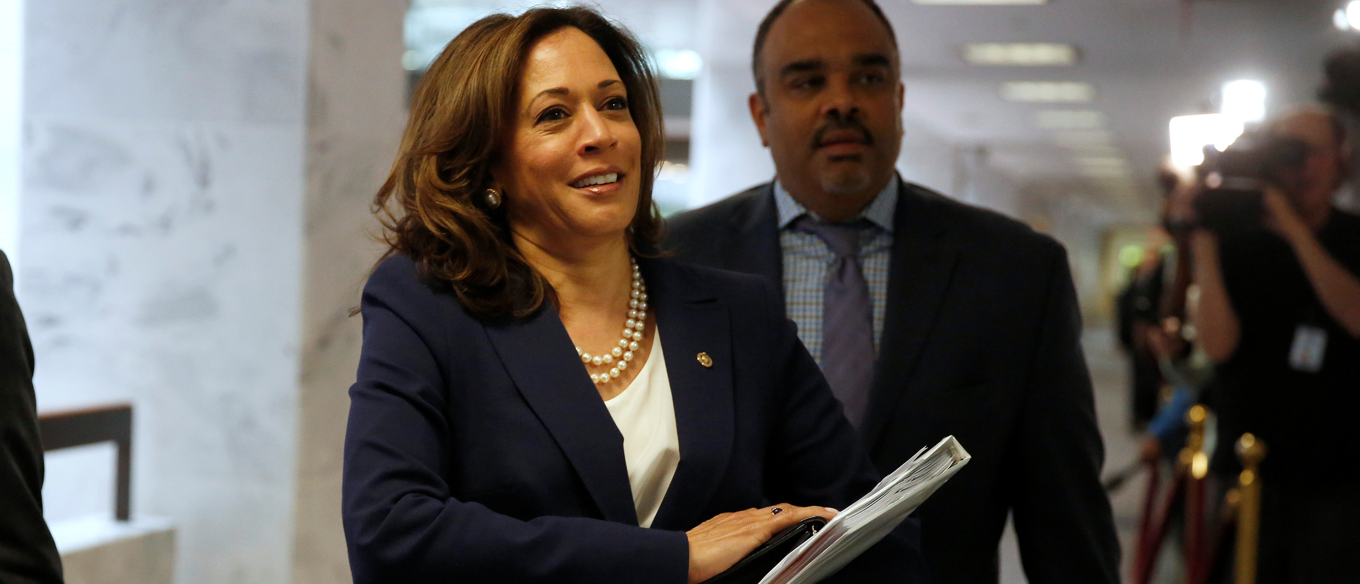 """Senator Kamala Harris (D-CA) arrives for a Senate Intelligence Committee hearing evaluating the Intelligence Community Assessment on """"Russian Activities and Intentions in Recent US Elections"""" on Capitol Hill in Washington, May 16, 2018.      REUTERS/Joshua Roberts"""