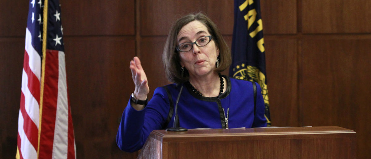 Oregon Governor Kate Brown speaks at the state capital building in Salem, Oregon , February 20, 2015. Brown, a liberal Democrat from Portland, outlined her policy agenda on Friday in her first media event since she took the helm of the Pacific Northwest state to replace John Kitzhaber, whose decades-long political career dissolved in the wake of an influence-peddling scandal involving his fiancee. REUTERS/Steve Dipaola | OR Gov Redacts Thousands Of Meetings