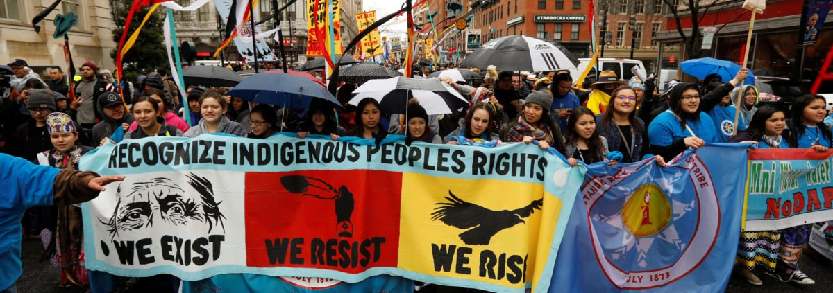 Members of the Standing Rock Sioux Nation and Indigenous leaders participate in a protest march and rally in opposition to the Dakota Access and Keystone XL pipelines in Washington, U.S., March 10, 2017. REUTERS/Kevin Lamarque - RC170A58FC40
