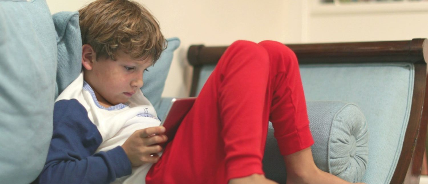 A child learning by using new technology. [Shutterstock - Bricolage]