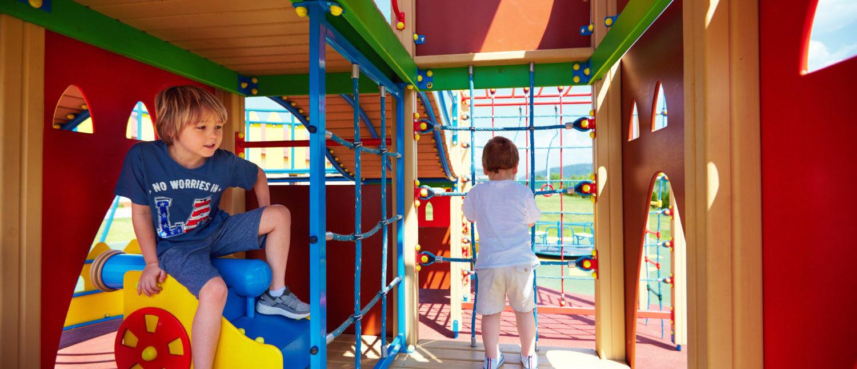 Kids Playing On Playground (CREDIT: Shutterstock/Olesia Bilkei)