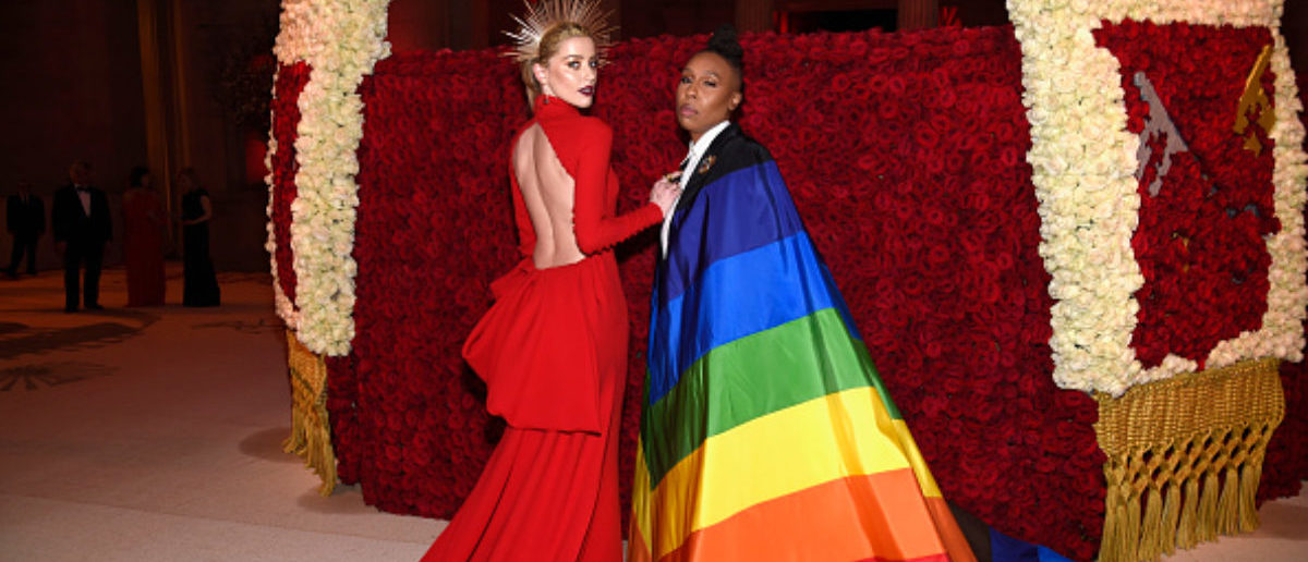NEW YORK, NY - MAY 07: Amber Heard and Lena Waithe attend the Heavenly Bodies: Fashion & The Catholic Imagination Costume Institute Gala at The Metropolitan Museum of Art on May 7, 2018 in New York City.  (Photo by Kevin Mazur/MG18/Getty Images for The Met Museum/Vogue)