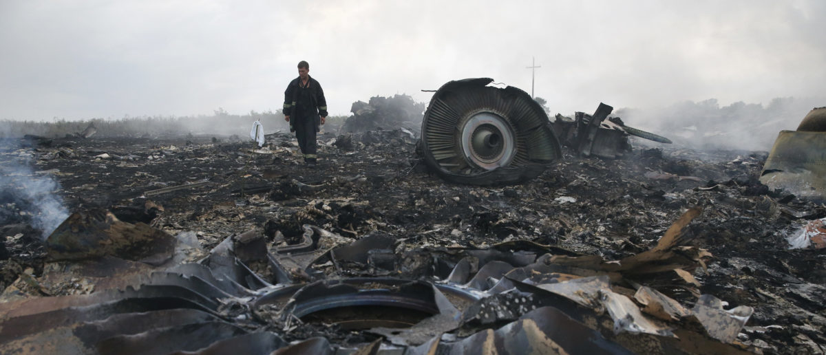 An Emergencies Ministry member walks at a site of a Malaysia Airlines Boeing 777 plane crash near the settlement of Grabovo in the Donetsk region, July 17, 2014. The Malaysian airliner flight MH17 was brought down over eastern Ukraine on Thursday, killing all 295 people aboard and sharply raising the stakes in a conflict between Kiev and pro-Moscow rebels in which Russia and the West back opposing sides. REUTERS/Maxim Zmeyev