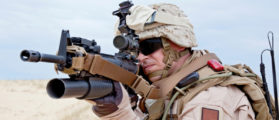 US marine aiming a gun with grenade launcher (SHUTTERSTOCK: By Getmilitaryphotos)