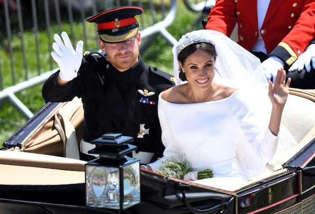 Britain's Prince Harry, Duke of Sussex and his wife Meghan, Duchess of Sussex wave from the Ascot Landau Carriage during their carriage procession on the Long Walk as they head back towards Windsor Castle in Windsor, on May 19, 2018 after their wedding ceremony. (Photo by Emmanuel DUNAND / AFP) (Photo credit should read EMMANUEL DUNAND/AFP/Getty Images)