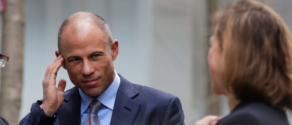 Michael Avenatti (C), attorney for Stormy Daniels, is pictured outside the Manhattan Federal Court in New York City, New York, U.S., April 13, 2018. REUTERS/Jeenah Moon - RC18C81C2A70