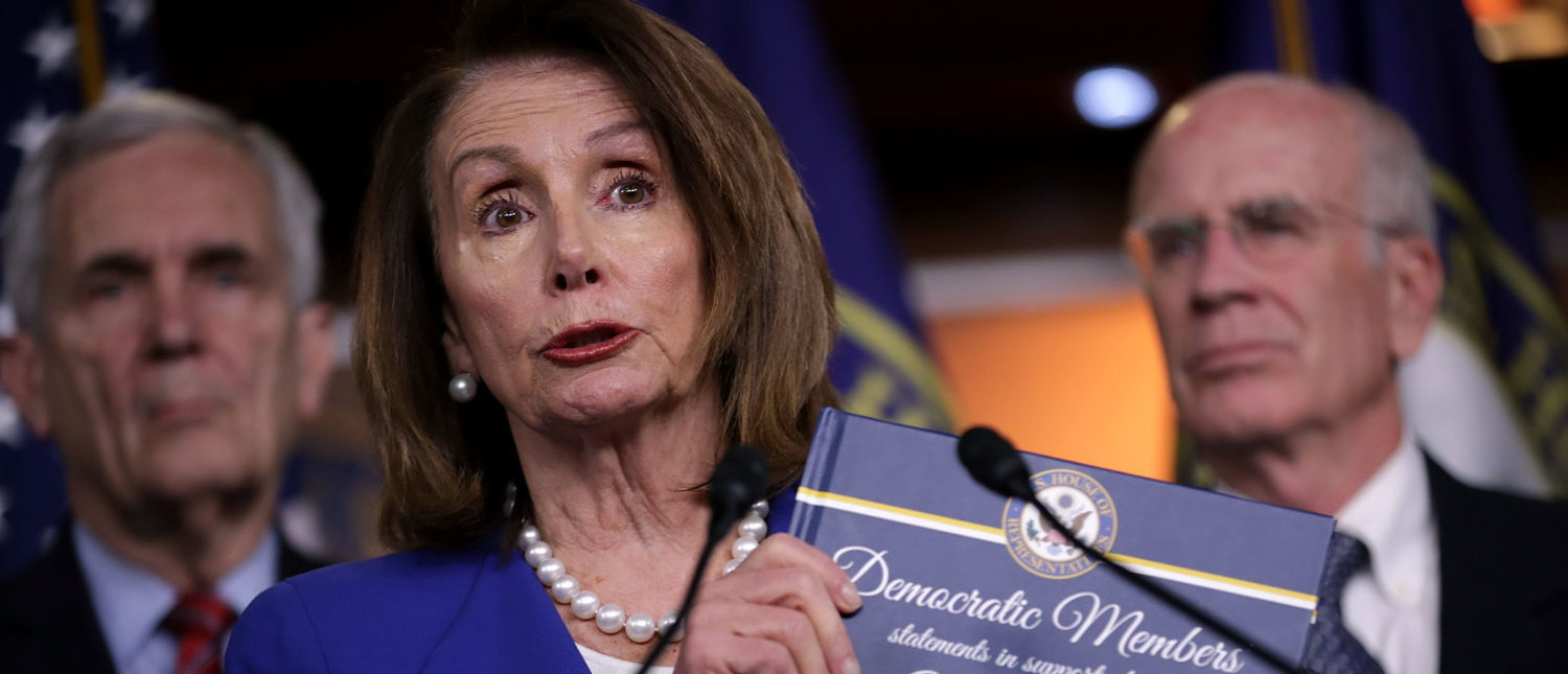 WASHINGTON, DC - MAY 10:  House Minority Leader Nancy Pelosi (D-CA) holds up a book of statements of support for the 2015 Iran nuclear deal during a news conference with fellow Democratic members in the U.S. Capitol Visitors Center May 10, 2018 in Washington, DC. Pelosi and House Democratic leaders were critical of President Donald Trump's decision to pull out of the nuclear agreement with Iran, saying the United States is isolated and that war in the Middle East is more likely.  (Photo by Chip Somodevilla/Getty Images)