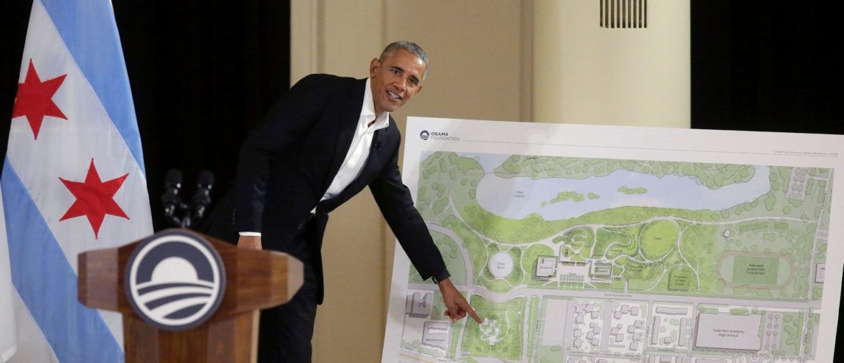 Former US President Barack Obama points to a location on a map that shows the design of the Obama Presidential Center as he speaks about the progress of the center | Obama Center Bait And Switch