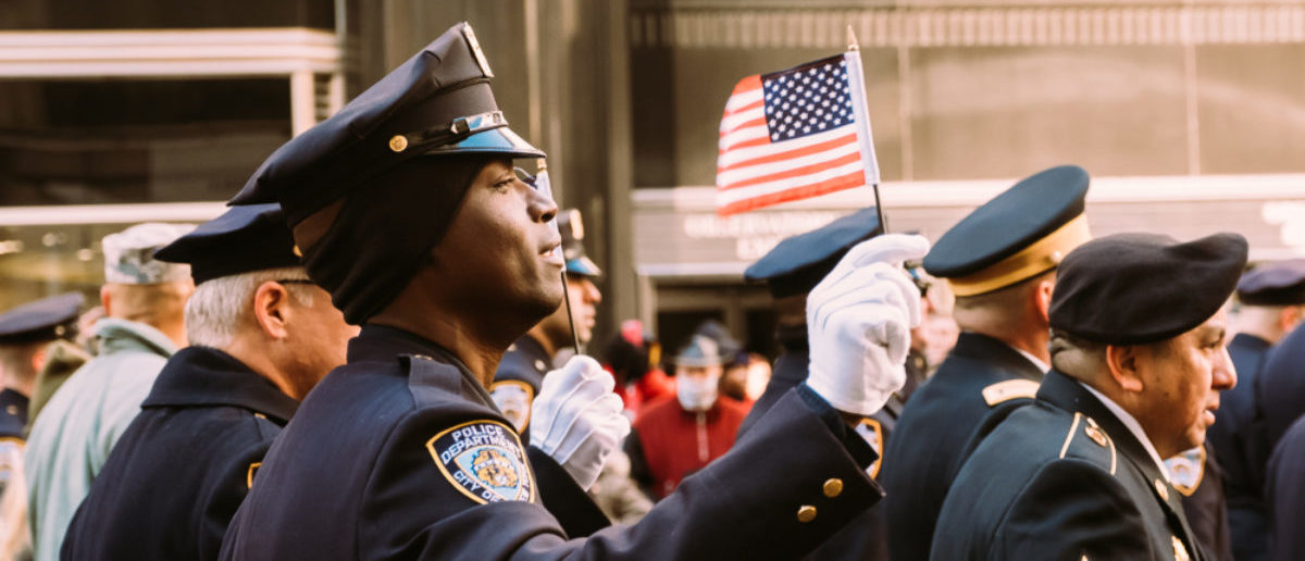 November 11th 2017 - New York, NY - At the Veterans day parade, an NYPD officer sings along to the national anthem. (SHUTTERSTOCK: By Christopher Lyzcen)