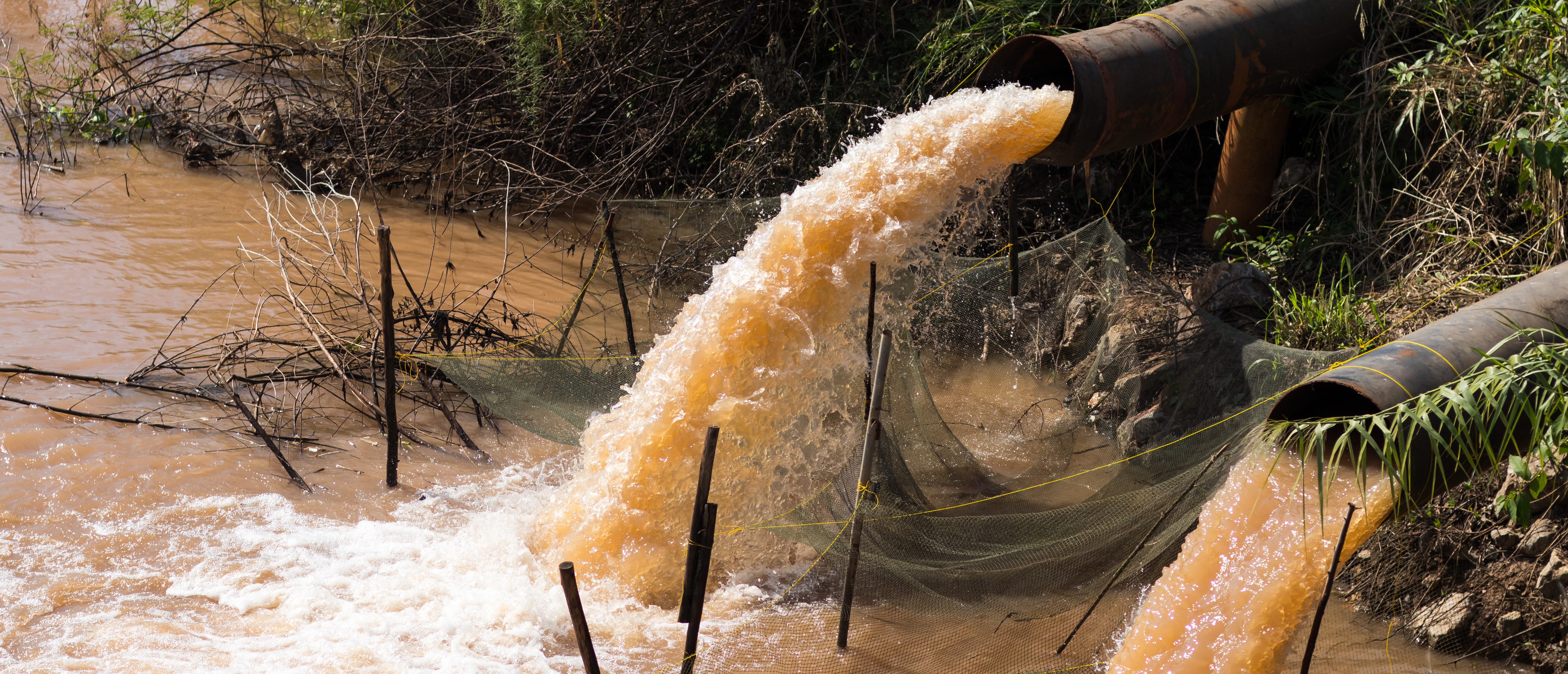 Close up of water gushing from the sewer to the coop in rural canals which flow stops recording. (Shutterstock)