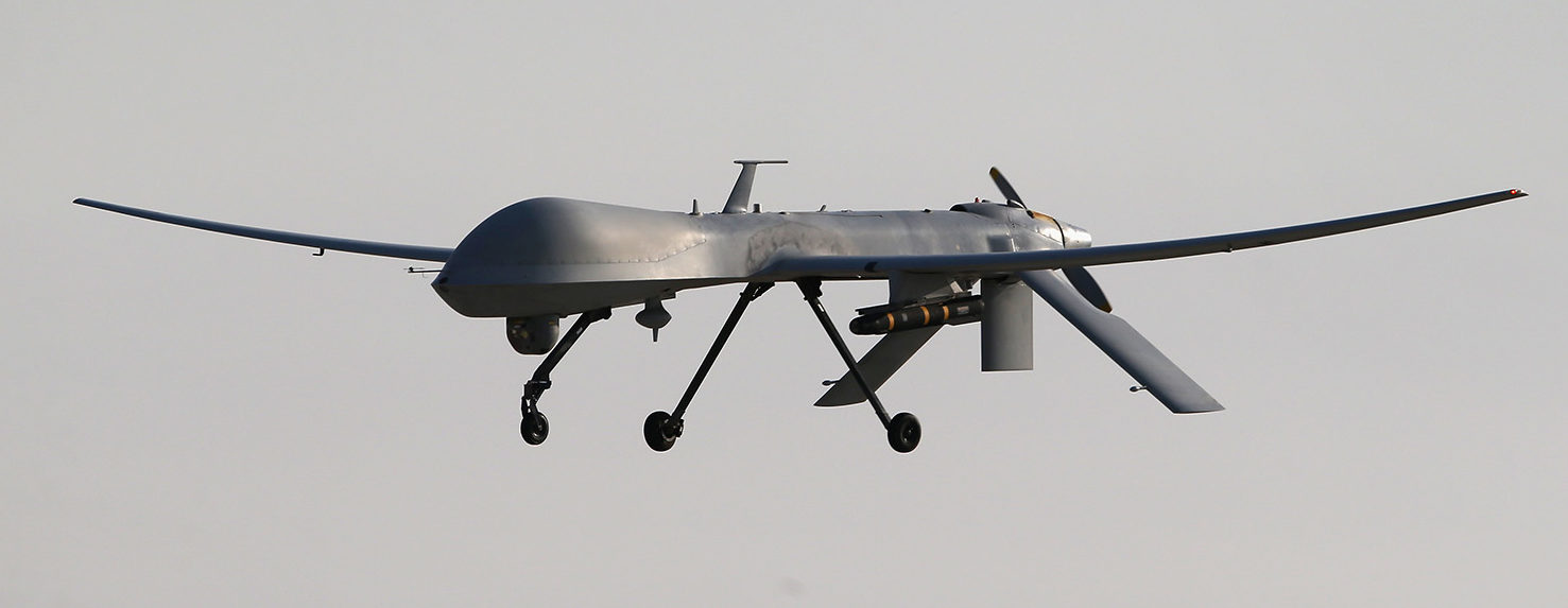 A U.S. Air Force MQ-1B Predator unmanned aerial vehicle (UAV), carrying a Hellfire missile lands at a secret air base after flying a mission in the Persian Gulf region on January 7, 2016. The U.S. military and coalition forces use the base, located in an undisclosed location, to launch airstrikes against ISIL in Iraq and Syria, as well as to distribute cargo and transport troops supporting Operation Inherent Resolve. The Predators at the base are operated and maintained by the 46th Expeditionary Reconnaissance Squadron, currently attached to the 386th Air Expeditionary Wing. (Photo by John Moore/Getty Images)