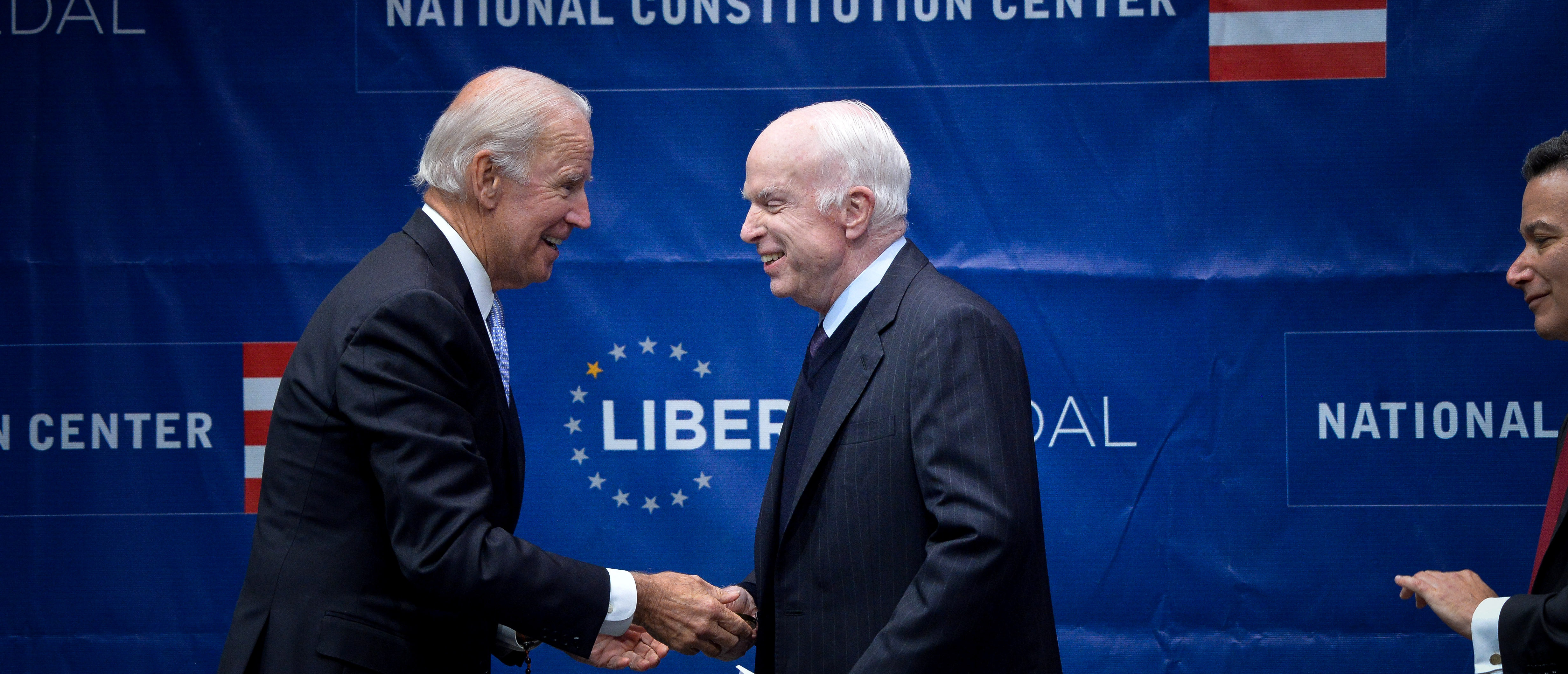 U.S. Senator John McCain (R-AZ) is awarded the 2017 Liberty Medal by former U.S. Vice President Joe Biden at the Independence Hall in Philadelphia, Pennsylvania, U.S., October 16, 2017. REUTERS/Charles Mostoller - RC1F9B30E210